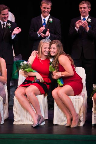 Carly Czeplewski (left) celebrating her coronation as homecoming queen with Allie Randall (right)