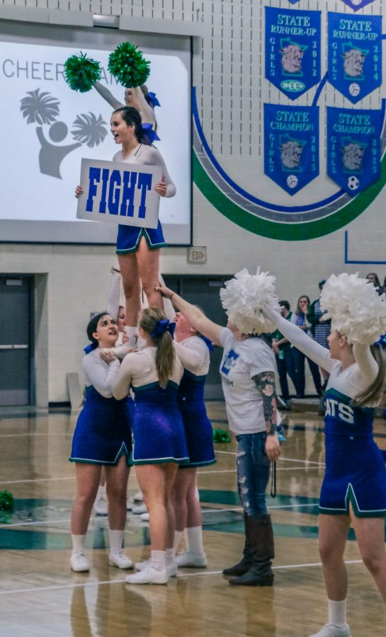 The cheer team performs at a pepfest