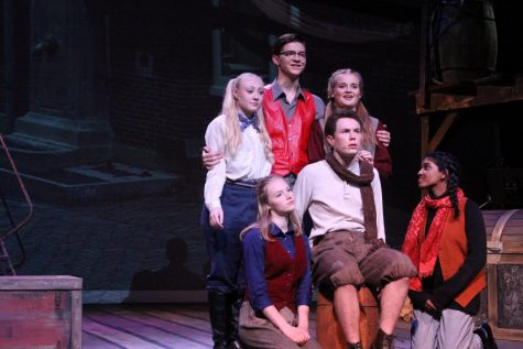 Peter (Jack Bechard) poses with several ensemble members.