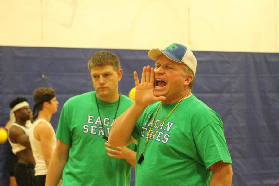 Coaches make an announcement to onlookers and competing teams.