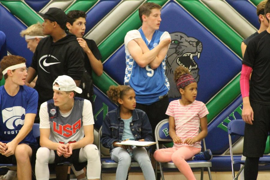 Young spectators look on the game.