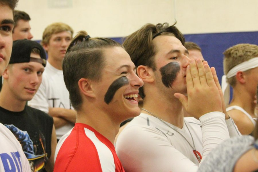 Spectators and competitors cheer on their classmates.