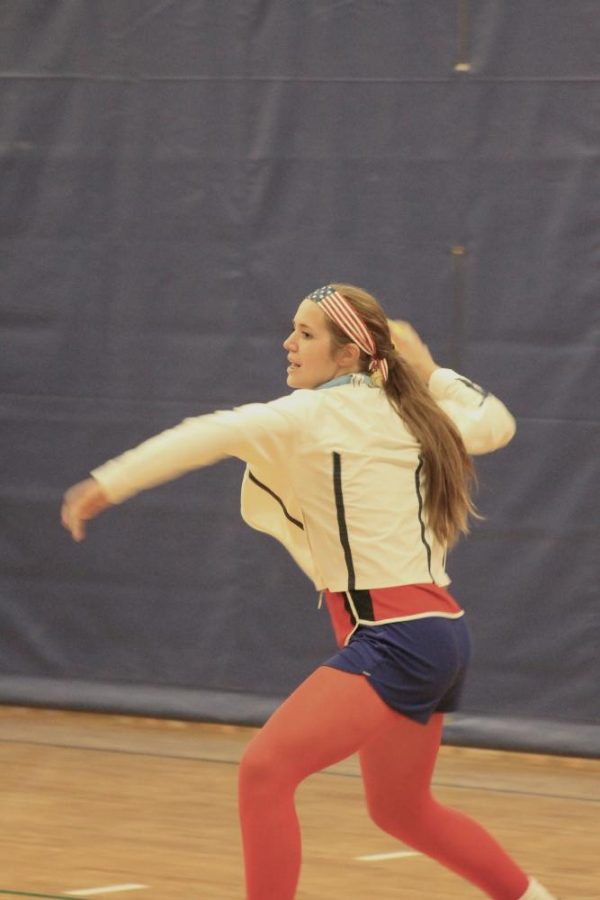 A player prepares to serve a ball to the opposing team.