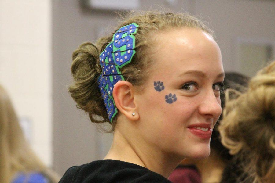 Sophmore Emma Veldheis waits for her baton twirling routine.