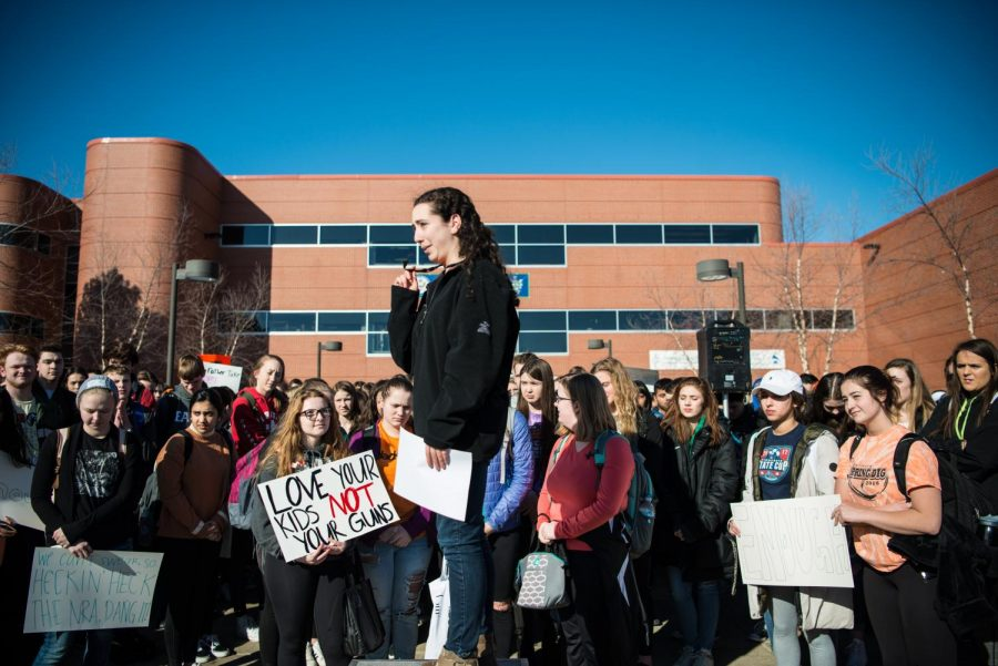 Student protest organizer Miriam Lebowitz speaks to hundreds of students at the walkout.