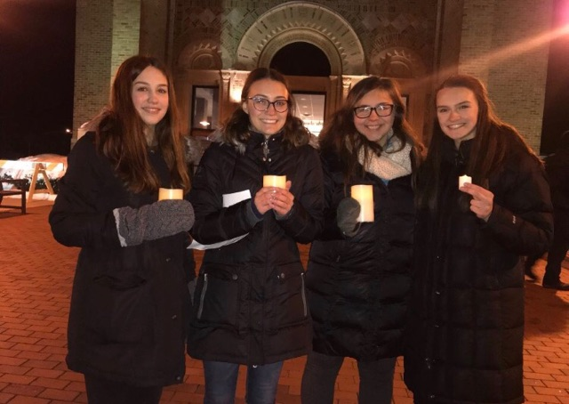 Walkout+organizers+Annika+Scott%2C+Emma+Anderson%2C+Lizzy+Sabel%2C+and+Macy+Harder+pose+for+a+picture+at+the+vigil.+Image+courtesy+of+Emma+Anderson.+