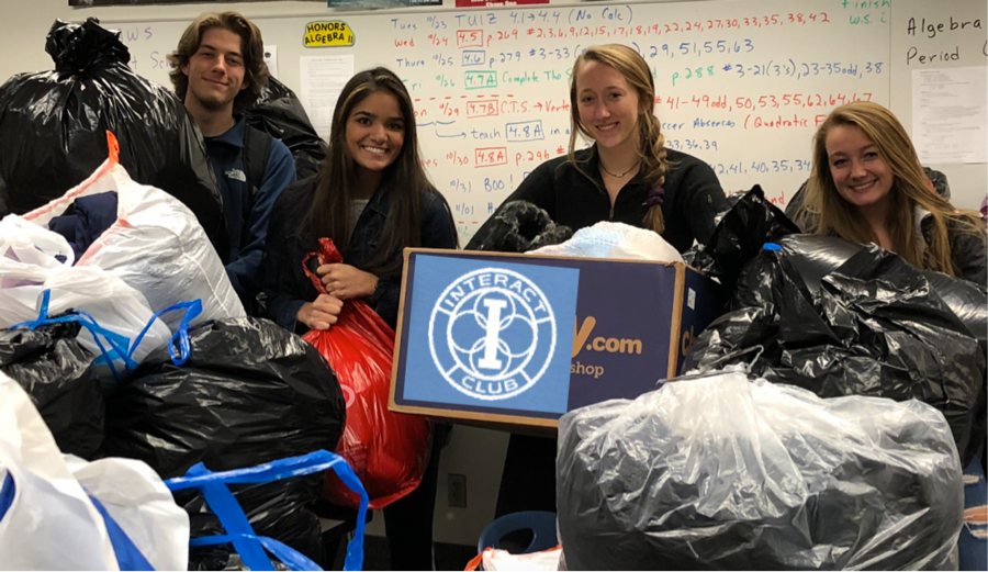 Interact co-presidents and members help transport coats