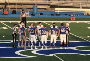 Football Captains walking to center field for coin toss at game vs. Park on Friday September 10th.
